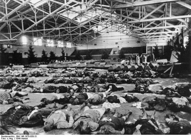 Dead laid out for identification after air attack. Bundesarchiv, Bild 146-1970-050-31/CC-BY-SA